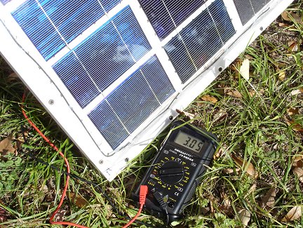 Here I am testing the current capacity of the panel, again in bright winter sunlight. My meter says 3.05 Amps short circuit current. That is right about what the cells are rated for.